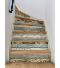 Wallpaper on the stairs to get them a weather, rustic look