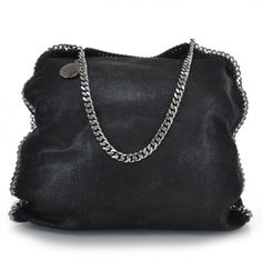 This is an authentic STELLA MCCARTNEY Faux Leather Falabella Tote in Black.   This stylish shoulder bag is crafted of fine shimmery faux   leather.  Love!!!!