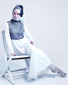 White dress with sheer black vest, white pashmina, black pashmina with silver glitter and black headpiece all by Irna la Perle. Silver diamante heels by Amante.