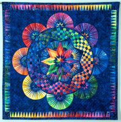 Love, love it!  Photos of awesome circle quilts.  Not for me to do, but this is stunning