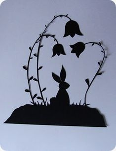Here is a free papercutting pattern of a bunny sitting amongst flowers for you! (I think he's resting before the big day!) Sketched by me. H...