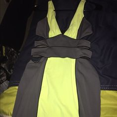 Grey and neon dress Grey and neon Bebe dress size small worn once bebe Dresses Mini