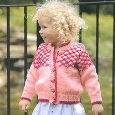 """Sweetheart Cardigan Knit ePattern - Number of Designs: 1 child's cardiganApproximate Design Size: 1 (24-1/2""""), 2 (26-1/2""""), 4 (27-1/2""""), 6 (30-1/2""""), 8 (32-1/2""""), 10 (33-1/2""""),Designer: Judy LambOriginal Publication: Leisure Arts Leaflet #3971, Knits for Kids Skill Level: IntermediateProduct Type: Digital Download†Description: Knit up a detail-rich sweater for your little sweetheart! The button-front design is perfect for a boy or a girl. Just change yarn colors and buttons, and the pretty…"""