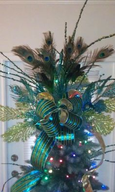 Another tree topper idea. Merry Christmas Baby, Blue Christmas, Retro Christmas, Beautiful Christmas, Christmas Holidays, Christmas Ideas, Christmas 2019, Holiday Ideas, Peacock Christmas Tree