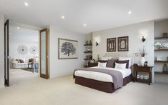 Master bedroom with double doors leading to the sitting area
