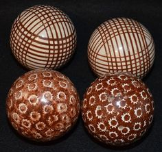 Antique Victorian Carpet balls Used in the Victorian game of carpet bowls, made in brown stoneware or white earthenware coloured with starry, ringed, or flowery patterns.