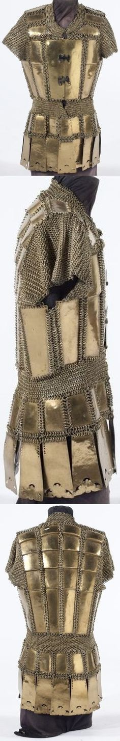 Moro (Philippines) brass mail and plate armor late 19th century, detail view of the closure, consisting of a cuirass with skirt, the latter element includes one plate which retains a partial manufacturer's stamp original to the host metal, 28 x 17 in.