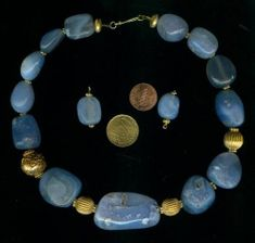 Ancient blue chalcedony agate beads from Afghanistan/Iran border. Strung with gold vermeil beads, gold plated brass beads with turquoise inlay and Bali vermeil. Exeptional piece of ethnic jewellery