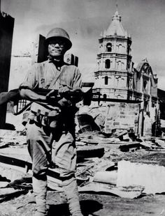 circa 1941: A Japanese soldier reviews the scene in Bataan after the invasion of the Philippines. (Photo by Keystone/Getty Images)