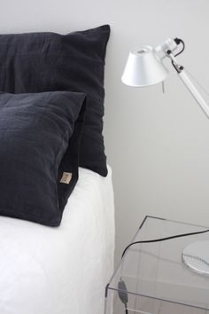 Homevialaura | timeless bedroom | Balmuir linen pillow case in dark grey | Artemide Tolomeo