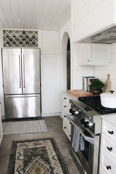 Shiplap Kitchen - Wine Rack Over Fridge - KitchenAid Appliances - The Inspired Room