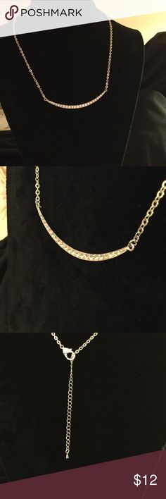 "ParkLane jewelry close outs Silver tone chain with a 3 inch half circle set with Russian crystals . Necklace is 19"" with 3"" extender. Lobster claw clasp. Beautiful statement piece Park Lane Jewelry Necklaces"
