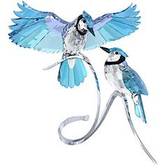 Swarovski Blue Jays - the Blue Jays are beautifully executed in cut crystal, featuring natural color combinations such as Blue Turquoise, Jet, and Lavender crystal. The stunning birds perch on a beautiful silver-tone metal display. Glass Figurines, Collectible Figurines, Glass Toys, Swarovski Crystal Figurines, Swarovski Crystals, Swarovski Jewelry, Glass Animals, Crystal Collection, Home Deco