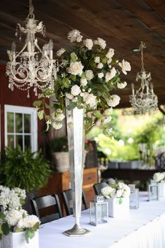 tall white rose centerpiece and chandelier.