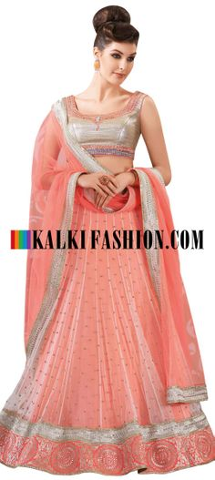 Buy Online from the link below. We ship worldwide (Free Shipping over US$100) http://www.kalkifashion.com/peach-lehenga-choli-with-stone-and-kundan-work.html Peach lehenga choli with stone and kundan work