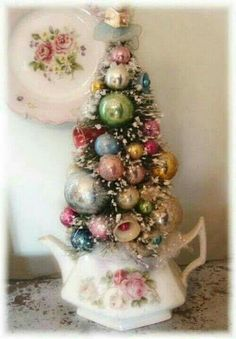 Shared by England in a Cup~www.etsy.com/shop/englandinacup Pretty in pastels Christmas bottle brush tree~!