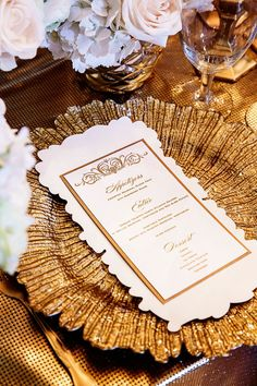 Gold chargers paired with elegant gold wedding stationery   Gold wedding editorial shoot   The New Indian Bride by Design House Decor   Photography: Nadia D. Photography   See the full styled photo shoot: http://www.xaazablog.com/gilded-wedding-editorial-behind-scenes-video/ #goldwedding #weddingdecor #floraldecor #weddingmenu