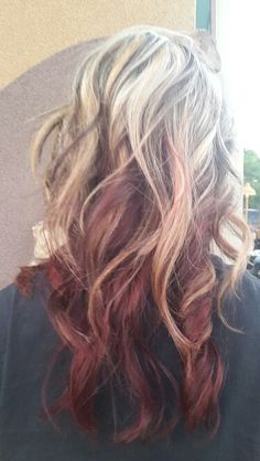 Blond with dark brown on top and some bright red underneath.