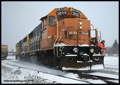 Chris and Rob hop aboard their designated 313 power GP40-2 2202 and GP38-2 1808 and make tracks for their 22 car Kapuskasing bound consist on track 1 through a stormy Cochrane Yard November 20th.
