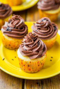 Classic Yellow Cupcakes with Chocolate Buttercream Frosting from scratch are as easy as using a mix! Easy recipe at averiecooks.com