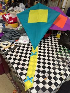 "Show: Mary Poppins Prop: a kite This was a kite that I worked on for ""Mary Poppins."" It was used in the musical number, ""Let's Go Fly a Kite."" This is a photo of one of the kites with the tail and bows added."