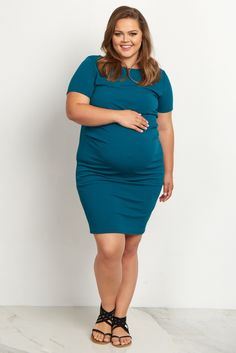 This not so basic plus size maternity dress is everything we love: simple, elegant, and stylish. Perfect to dress up or down for any occasion, this fitted maternity dress is oh-so-soft and its short sleeves are perfect for warm weather. Slightly ruched sides hug just the right places, while a fitted style shows off your growing baby bump.