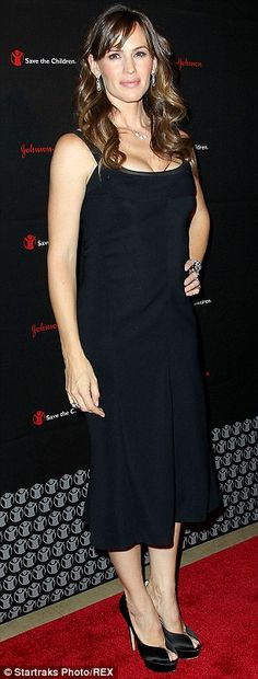 Taking the plunge: Jennifer sported an unusually low cut dress teamed with towering peep t...