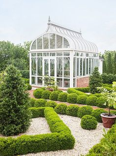 This New Orleans estate has the most beautiful formal gardens and greenhouse!