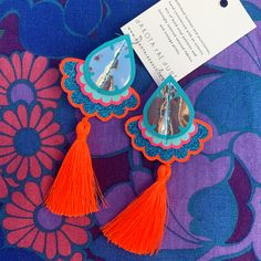 These statement tassel earrings have been cut from vinyl printed fabric and stitched together. They are adorned with silky neon tassels and despite their size, are LIGHT WEIGHT and easy to wear. nice and bright X Turquoise Tassel Earrings, Fabric Earrings, Pink Earrings, Statement Earrings, Crochet Earrings, Textile Jewelry, Jewellery, Vintage Floral Fabric, Orange And Turquoise