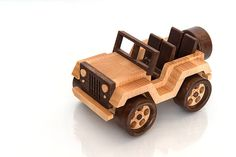 I made this fun Jeep Wrangler wooden toy off-road vehicle from beech, maple and oak. Vehicle with rotating wheels. No nails or screws, just glue, natural linseed oil. All very child-safe. Dimension: Length: 5.90 inches (15 cm) Width: 3.86 inches (9.8 cm) Height: 3.15 inches (8 cm)