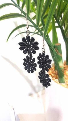 Check out this item in my Etsy shop https://www.etsy.com/au/listing/551438833/black-lace-flower-double-drop-earrings
