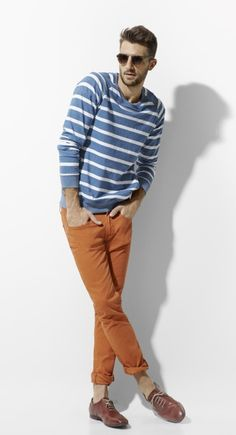 Color combination.  Blue and white striped top with orange pants.