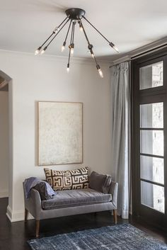 A perfect chair for this space would be our Claire barrel chair! Use a simple grey fabric for a simple, calming feel.