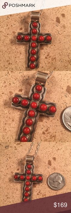 Vintage Coral & Sterling Delbert Delgarito Cross Vintage Navajo Sterling Silver & Coral Cross is made by the famous Artist Delbert Delgarito. The length of the pendent is 2 1/2 inches long and 1 1/2 inches wide.. This piece is in very good vintage condition. (Pendant only) signed by the artist and stamped Sterling.   Thank you for checking out our store. Please contact us with any questions. Jewelry Necklaces