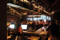 Hip bar & restaurant Los Angeles Above bar floating shelves lit up