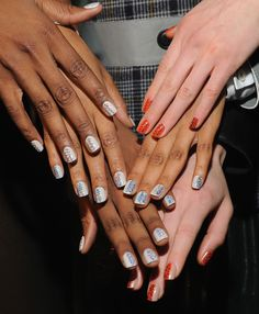 Fashion Week: Get the CND Graffiti Nails Look | Salon Fanatic Apply CND Shellac in Impossibly Plush vertically to one-third of the nail. Apply CND Shellac in Electric Orange vertically to the rest of the nail. Use a detail brush and CND Shellac in Blue Rapture to create waves on top of the orange side of the nail. Repeat with CND Shellac in Seaside Party. Repeat with CND Shellac in Faux Fur.