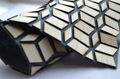 Geometric Textiles Design - flexible wooden fabric with felt base & laser cut wood for pattern & texture // Laura Krumina