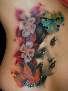Beautiful black and white vintage portrait tattoo with color floral vignette