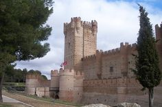 Castillo de la Mota, Valladolid, Castile and LeonInitial, Spain.   Initial fortification of the village, repopulated after Moorish depredations, led to the creation of a fortress on the site, starting in 1080. The village soon grew alongside. In 1354, Henry of Trastamara is known to have taken the fortress by force. In 1390 King John I of Castile granted the town to his son, the infante Ferdinand of Antequera, future king of Aragon. After the latter's death in 1416, his son, John II of…