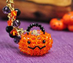 I am so in love with this...could never do it but it's so cute!!  3D Beaded Haunted Pumpkin PATTERN Halloween