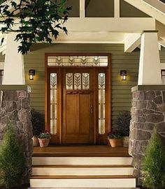 10 Eye-Catching Options for Your Front Door, It looks like wood, but it's not. This Craftsman-style fiberglass door with decorative glass and sidelites looks as warm as solid wood but offers better durability and insulation value.