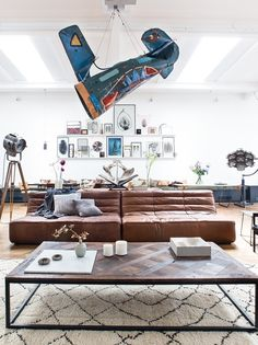 A breathtaking loft in Amsterdam is decorated using elements of industrial and modern design and a collection of carefully picked accent pieces. So amazing that they have used a salvaged airplane piece as a focal point and hanging decorative statement in the room! I also love the floor lamps, such as the one on the easel, that looks like something from the 1920s. A very unique and personalized room.