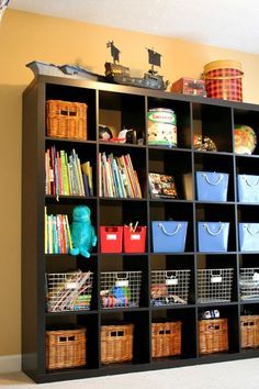 Great way to use the Expedit for storing kids toys, now where did she find those blue bins & metal mesh bins?