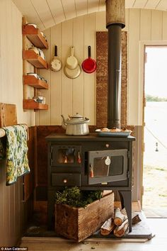 'I wanted both a wood-burner and oven in the hut,' says Sarah. 'This is a new piece sourced from Belgium, but eventually I would like to find an antique one to complete the look' Wood Shingles, Shepherds Hut, Log Burner, Tiny Spaces, Cottage Interiors, Fireplace Design, Eco Buildings, Furniture Making, Cosy