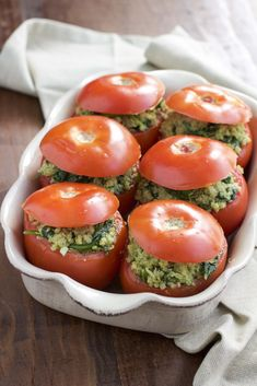 If you like stuffed peppers you'll LOVE stuffed tomatoes!  Roasted stuffed tomatoes that are filled to the brim with a flavorful mixture of pesto quinoa and fresh spinach. Vegan, dairy-free, and gluten-free. Veggie Dishes, Pasta Dishes, Side Dishes, Lunch Recipes, Veggie Recipes, Vegetarian Recipes, Healthy Recipes, Cooking Recipes, Fast Recipes