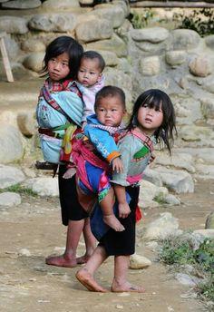 Babies wearing babies or little people being big people.