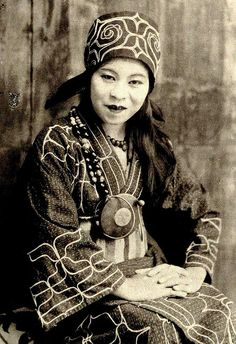 Ainu woman of old Hokkaido, one of the indigenous people of northern Japan, in traditional garments, 1890s