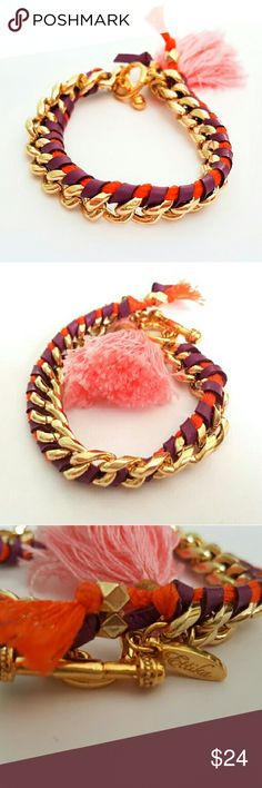 Ettika Woven Chain Link Bracelet This cute bracelet features gold tone chain with purple, red, and pink thread. It is in good pre-owned condition with only minor signs of wear. Ettika Jewelry Bracelets