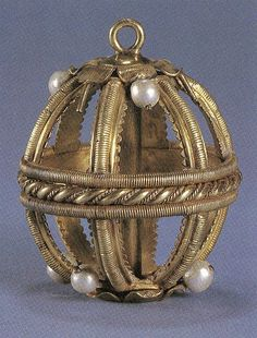 This Tudor pomander or musk ball was found on the Surrey bank of the Thames in 1854. The frame of the pomander has survived intact with five of the twelve pearls but none of the original enamel decoration. The central tubular shaft contains a thread in the upper section and the small ring-topped gold screw fastens the remaining five separate elements together once they have been assembled. This meant that the whole thing could be taken apart easily and the pomander refilled.
