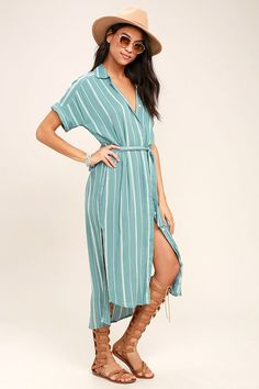 Be the queen of the beach scene in the O'Neill Alexandra Turquoise Blue Striped Shirt Dress! Breezy woven turquoise blue and white striped fabric sweeps over a collared neckline, into short, rolled sleeves, and a button-up bodice. Sash belt ties above the high-low midi skirt (with short side slits). Metal logo tag at back.